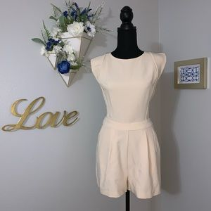 Dresses & Skirts - Cap sleeves Cream romper. Lace back. NWT. Size M